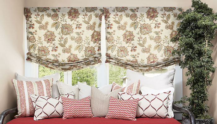 Fabric roman shades in the bedroom